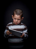 Child using tablet Stock Images