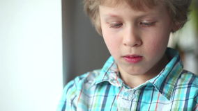 Child using tablet pc.Teenager boy using touch pad . Entertainment with tablet PC stock video footage