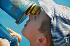 Child using telescope Stock Images