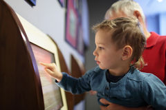 Child using touch screen Royalty Free Stock Images