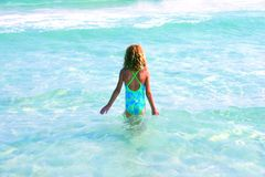 Child on vacation. Girl staring at tropical water royalty free stock photography