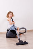 Child with vacuum cleaner. Royalty Free Stock Images