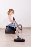 Child with vacuum cleaner. Stock Image