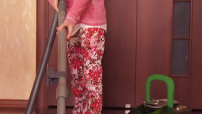 Child vacuuming the room. stock video