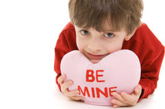 Child with Valentine pillow Royalty Free Stock Image