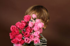 Child with Valentine's Day Flowers Stock Image