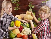 Child with vegetable on kitchen. Royalty Free Stock Photos