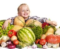 Child with vegetable on kitchen. Royalty Free Stock Image