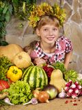 Child with vegetable on kitchen. Stock Images