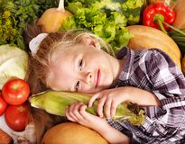 Child with vegetable on kitchen. Royalty Free Stock Photography