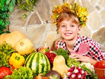 Child with vegetable on kitchen. Royalty Free Stock Photo