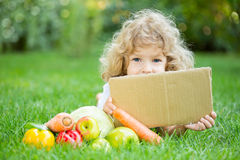 Child with vegetables Stock Photography