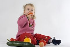 Child with vegetables. Child surround of healthy vegetables Stock Images
