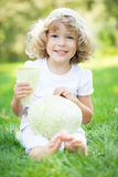 Child with vegetables in spring park Stock Photography