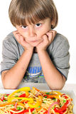 Child with veggie pasta Stock Image