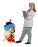Child vet and silly dog Royalty Free Stock Images