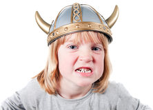 Child viking angry. Angry child with viking helmet. boy isolated on white with expression of aggression. blond kid dressed up Royalty Free Stock Photography