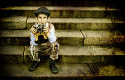 Child with vintage camera Stock Photos