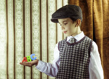 Child in vintage clothes hold letters a b c Royalty Free Stock Photos
