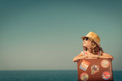 Child with vintage suitcase on summer vacation Royalty Free Stock Photos