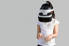 Child with Virtual Reality, VR, Headset Studio Shot Isolated on White Background. Kid Exploring Digital Virtual World with VR. Studio shot of child with virtual royalty free stock images
