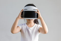 Child with Virtual Reality, VR, Headset Studio Shot Isolated on White Background. Kid Exploring Digital Virtual World with VR stock photography