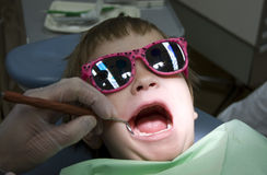 Child visit at the dentist. Child during visit at the dentist royalty free stock images