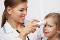 Child visiting doctor Stock Image