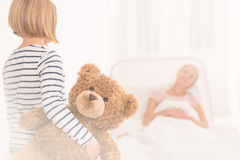 Child visiting mother at hospital stock image