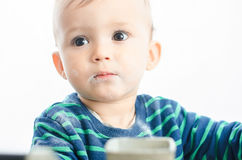 Child vypuskala in sugar. The cute Child vypuskala in sugar and looks guilty Stock Photo