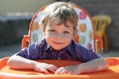 Child waiting breakfast Royalty Free Stock Image