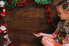Child waiting for Christmas miracle Royalty Free Stock Images