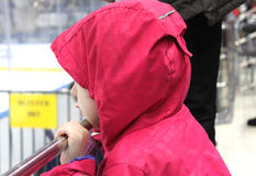 A child waiting for the puck stock image