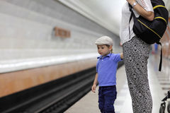 Child waiting train Stock Images