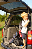 Child Waiting in Van to Leave for Vacation Stock Image
