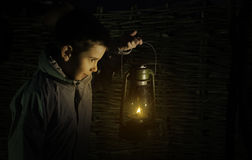 Child walk in the darkness. With gas lantern Royalty Free Stock Photo