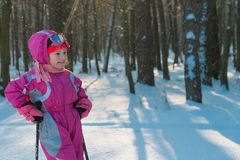 Child. a walk in the forest in winter snow child royalty free stock photography