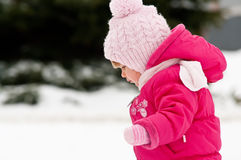 Child walk in snow Stock Images