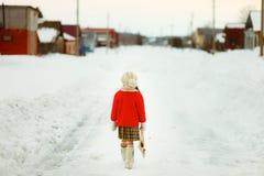 Child walk on street. Stock Image