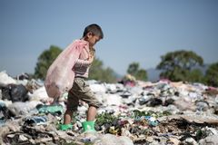 Child walk to find junk for sale and recycle them in landfills, the lives and lifestyles of the poor, The concept poverty, child. Labor and human trafficking royalty free stock photography
