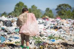 Child walk to find junk for sale and recycle them in landfills, the lives and lifestyles of the poor, The concept poverty, child. Labor and human trafficking stock photo