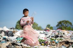 Child walk to find junk for sale and recycle them in landfills, the lives and lifestyles of the poor, The concept poverty, child. Labor and human trafficking royalty free stock image