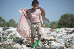 Child walk to find junk for sale and recycle them in landfills, the lives and lifestyles of the poor, The concept poverty, child. Labor and human trafficking stock image