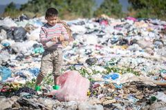 Child walk to find junk for sale and recycle them in landfills, the lives and lifestyles of the poor, The concept poverty, child. Labor and human trafficking stock photos
