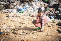 Child walk to find junk for sale and recycle them in landfills, the lives and lifestyles of the poor, The concept poverty, child. Labor and human trafficking stock images