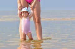 Child walk in water Stock Photos