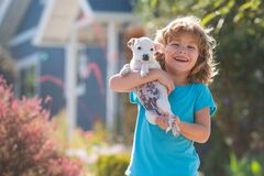 Free Child Walk With A Dog Outdoor. Cute Kid Hug Puppy. Royalty Free Stock Photo - 196930895
