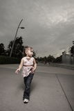 Child walking alone Stock Images
