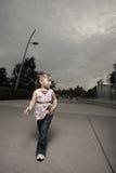 Child walking alone Stock Images