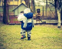 Child walking with ball Royalty Free Stock Photo